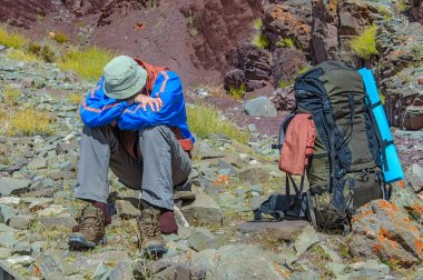 Trekker resting in height mountain