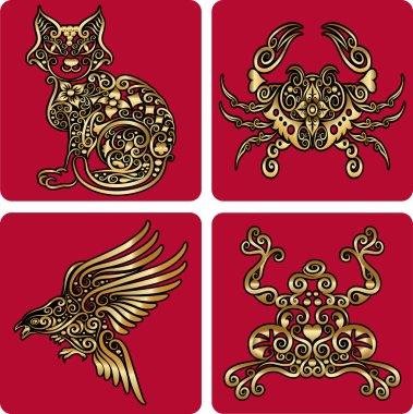 Golden animal ornaments (cat, crab, bird, frog)