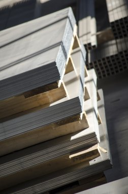 sheet metal on wooden palettes