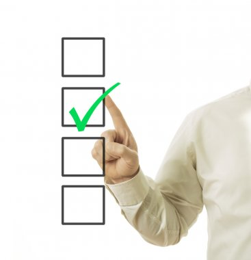 businessman hand and checkbox with green mark in it