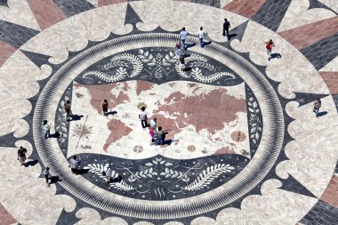 Huge compass rose in Lisbon with world map showing Portuguese di