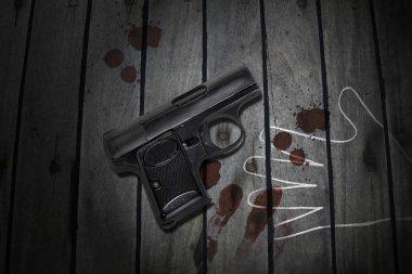 Crime, gun on the table