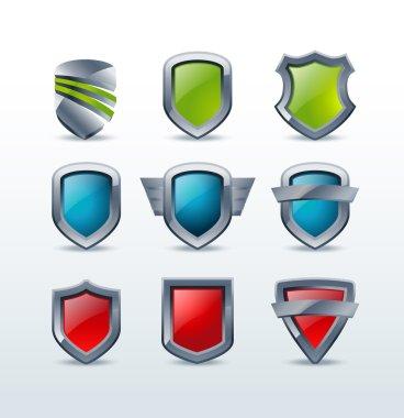 Set of colorful shiny metallic shield icons vector illustration