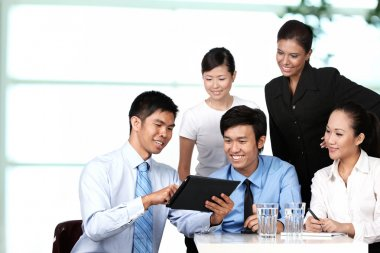Business colleagues looking at a touchpad