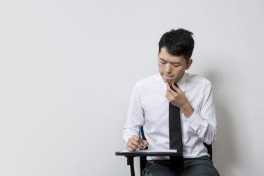 Chinese man taking an test or exam