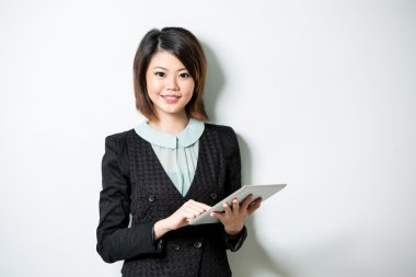 Asian woman with a tablet computer.