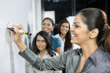 Indian Business women discussing ideas.