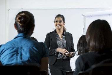 Indian business woman giving presentation