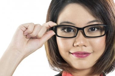 Close-up of young Chinese Woman wearing glasses
