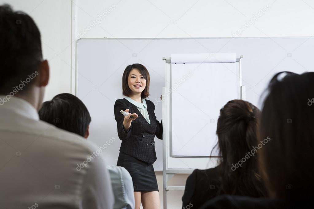 Chinese Business woman giving presentation.