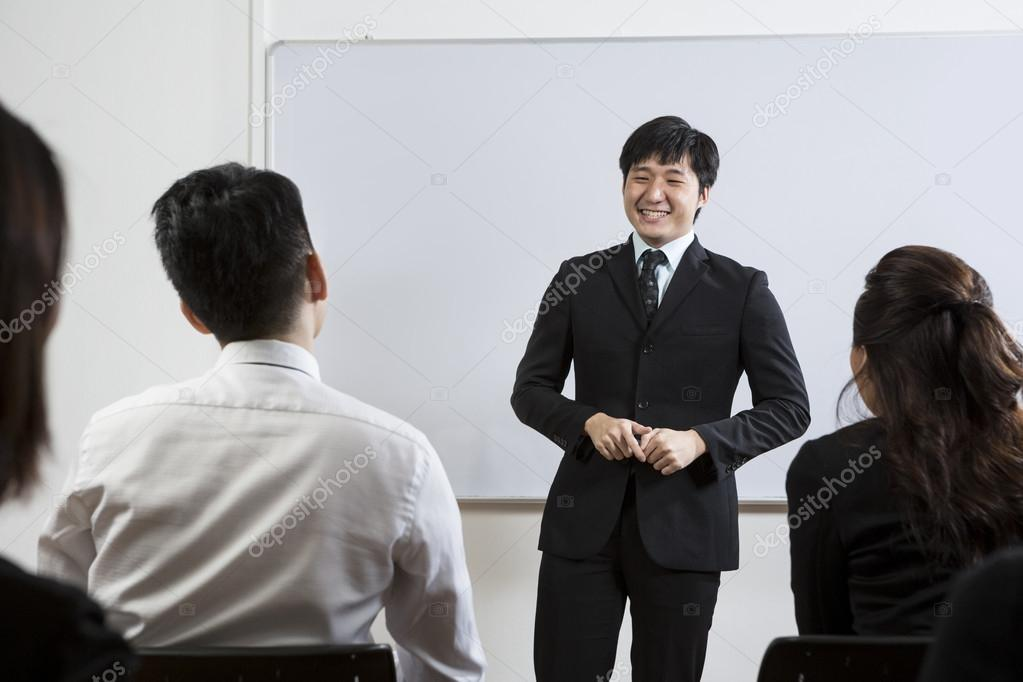 Chinese Business man giving presentation