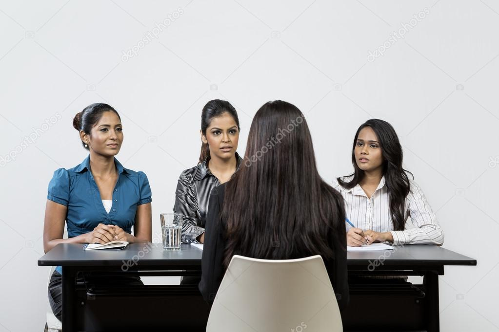 Panel of indian women interview applicant.