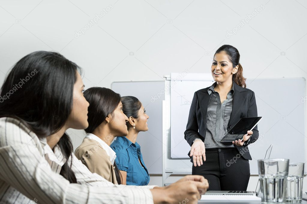 Businesswoman giving presentation with digital tablet.