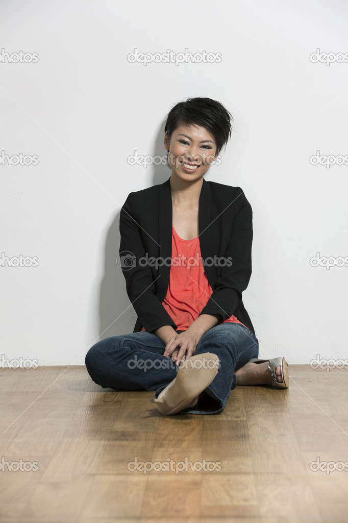 Stylish Young Chinese Female Model Sitting On The Floor
