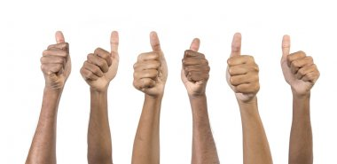 Close-up of a business peoples Thumbs Up