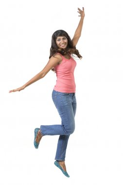 Excited Indian woman jumping for joy.
