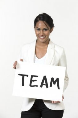 Indian businesswoman holding a white banner with word 'Team'.