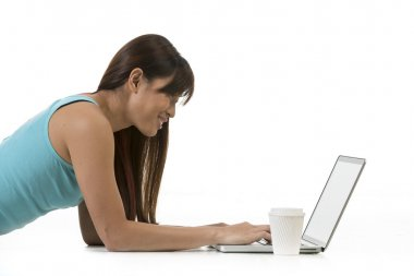 Asian Woman working on a laptop.