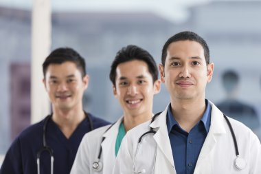 Team of male doctors and medical support staff