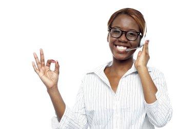 Customer service agent showing okay gesture