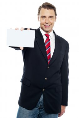 Confident sales representative presenting blank placard