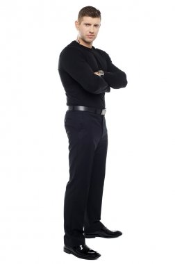 Handsome young bodyguard, full length portrait