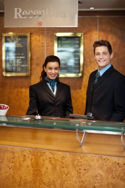 Trendy adorable couple at front office desk