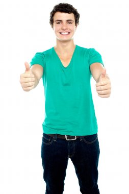 Guy showing thumbs up, arms stretched out