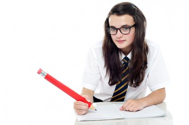 Snap shot of calm and relaxed young schoolgirl