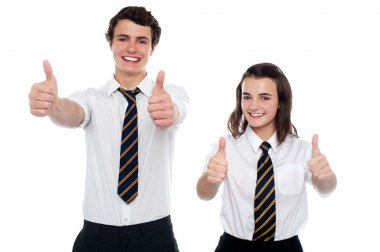 Students showing thumbs up to camera