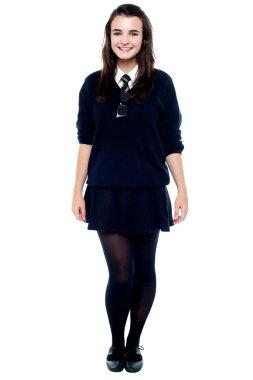 Full length portrait of pretty girl in school uniform