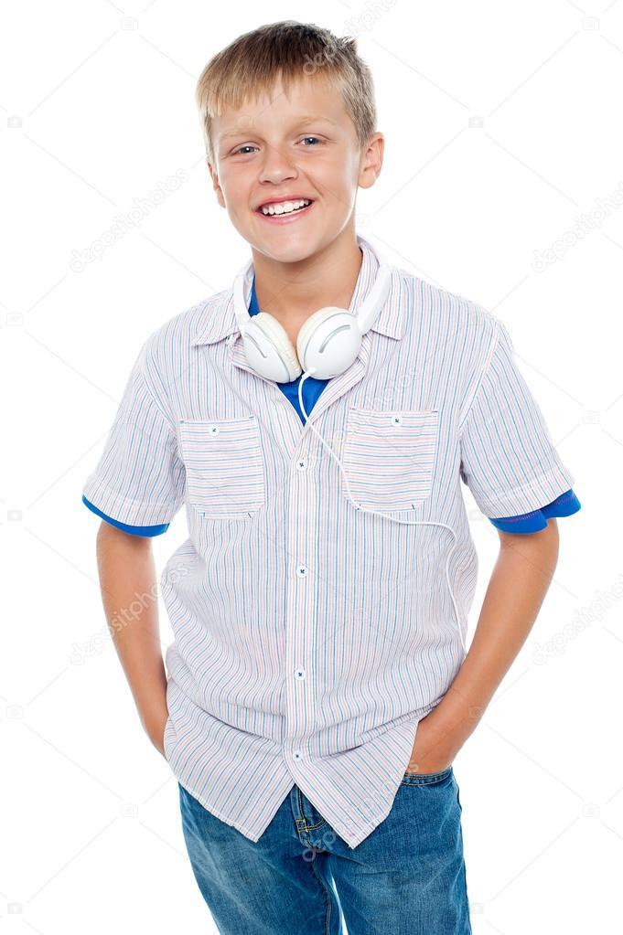 Fashionable kid posing with headphones around his neck
