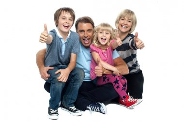 Cheerful thumbs up family