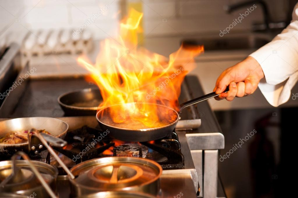 Chef cooking in kitchen stove