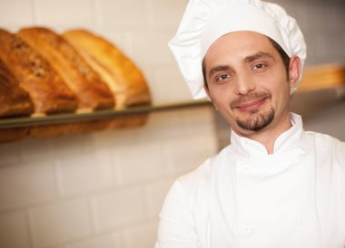 Bakery owner dressed in chef's attire