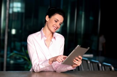 Corporate lady operating new tablet device