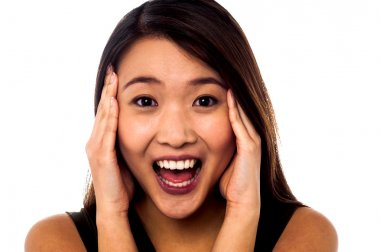 Surprised young girl with open mouth
