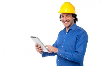 Construction worker operating tablet pc