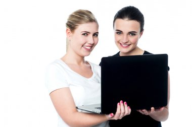 Smiling caucasian girls using laptop
