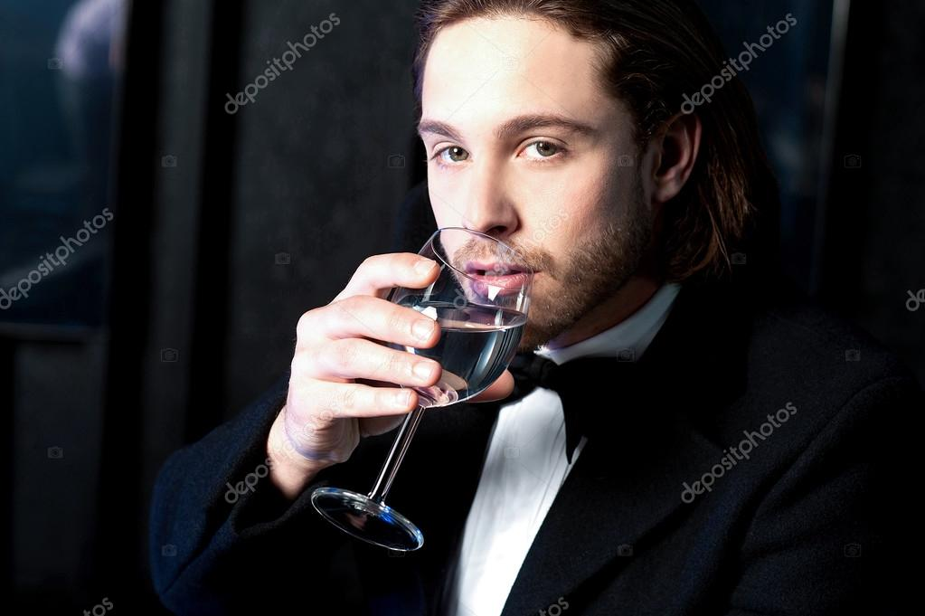 Guy in tuxedo drinking cocktail