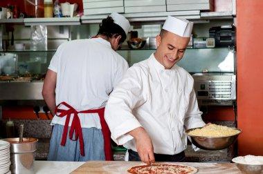 Expert chefs at work inside restaurant kitchen