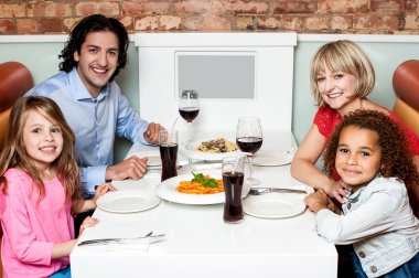 Cheerful family of four in a restaurant