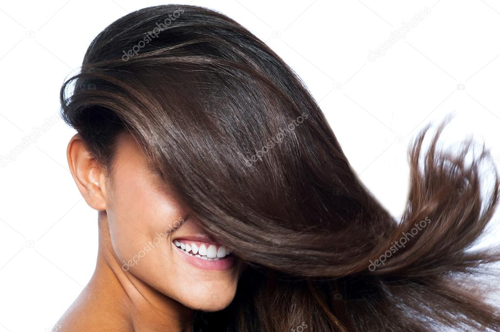 Lady's face covered with long straight hair