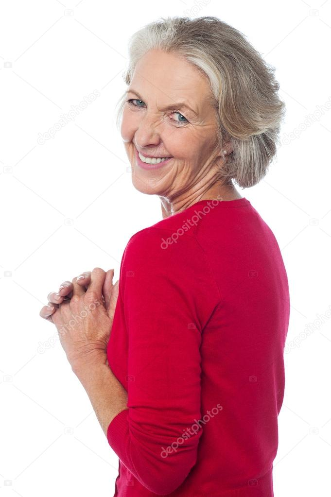 Aged woman looking over her shoulders