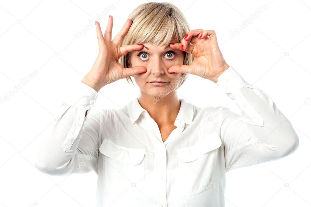 Matured woman with eyes wide open