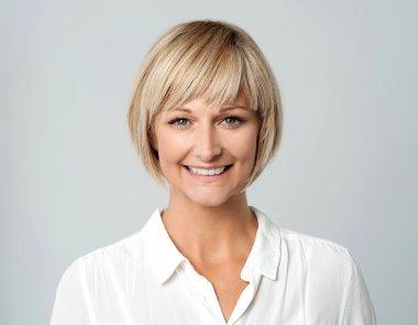 Smiling middle aged lady, studio shot.