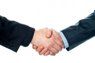 Businessmen shaking hands, closeup shot.