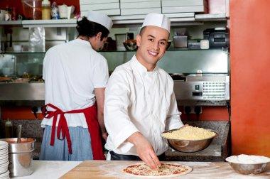 Chefs at work inside restaurant kitchen