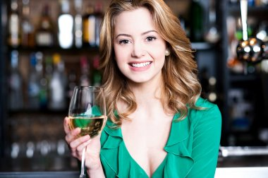Young girl with a glass of champagne