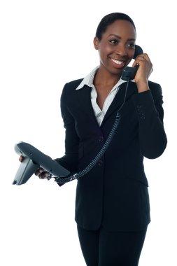 Female secretary speaking on phone